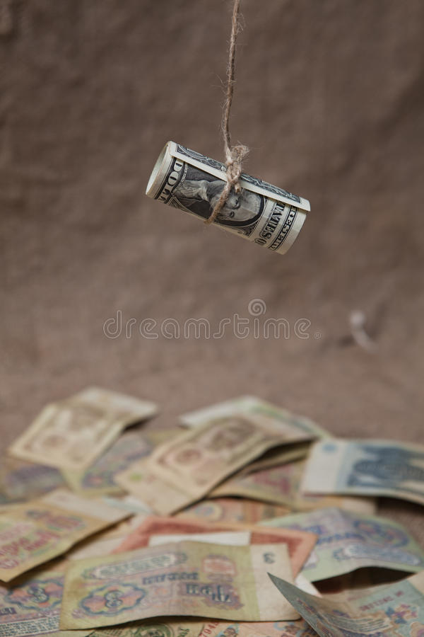 The dollar, tied with a rope. A symbol of financial crisis and old Soviet banknotes royalty free stock images