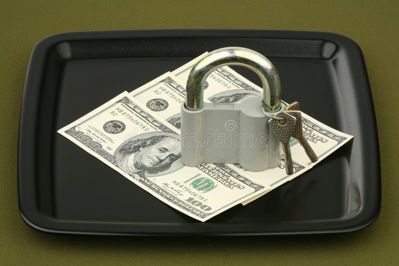 Dollar unter der Verriegelung lizenzfreies stockfoto