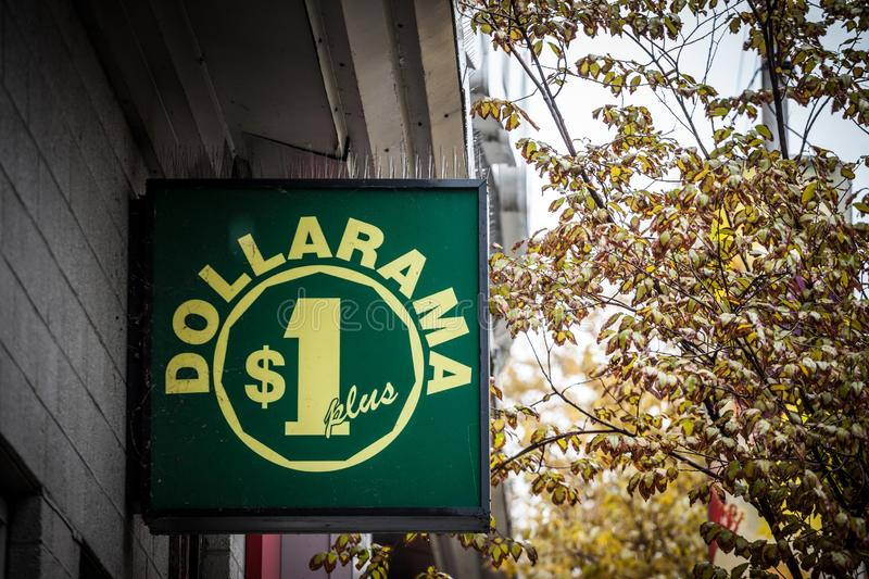 Dollarama logo in front of their local shop in downtown Montreal, Quebec. Dollarama is a Canadian chain of hard discount stores. MONTREAL, CANADA - NOVEMBER 5 royalty free stock photography