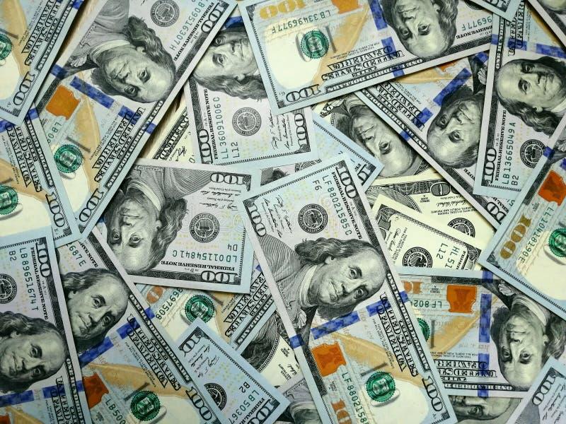 Dollargeld De achtergrond van het dollarcontante geld De bankbiljetten van het dollargeld stock afbeeldingen