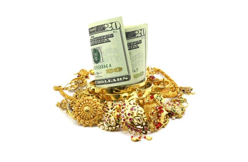 Dollari americani o gioielli dell'oro e dei soldi fotografie stock