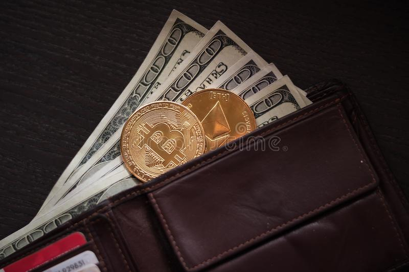 Dollari, bitcoin ed etere immagini stock