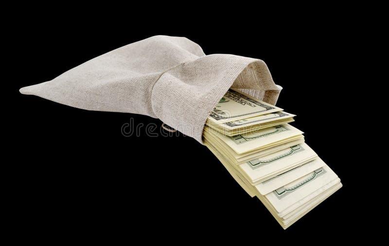 Dollari che vengono dal sacchetto. immagine stock