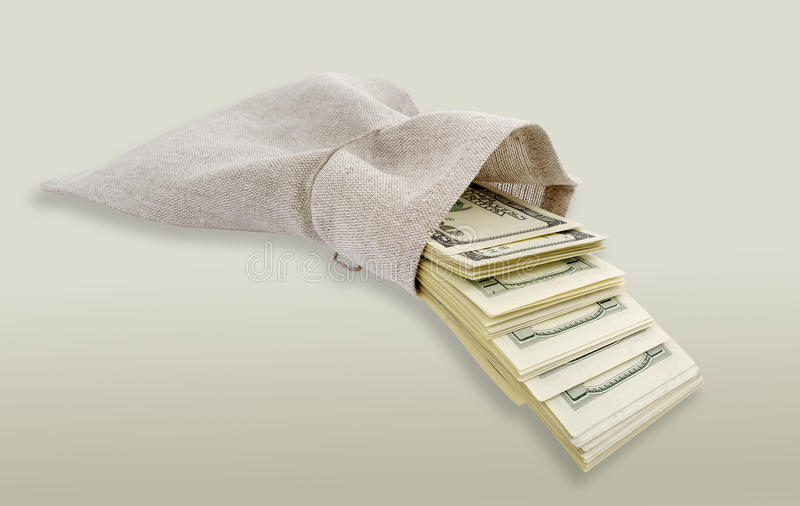 Dollari che vengono dal sacchetto. fotografia stock libera da diritti