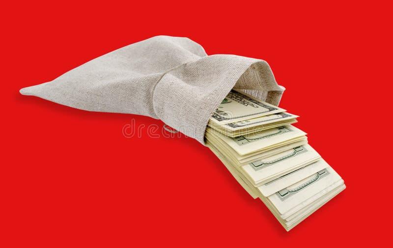 Dollari che vengono dal sacchetto. fotografie stock