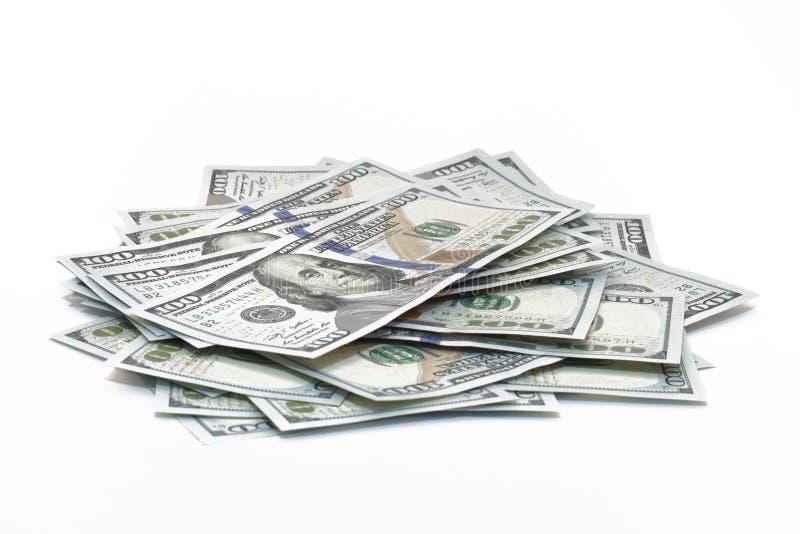 Dollari del mucchio isolati su bianco fotografie stock