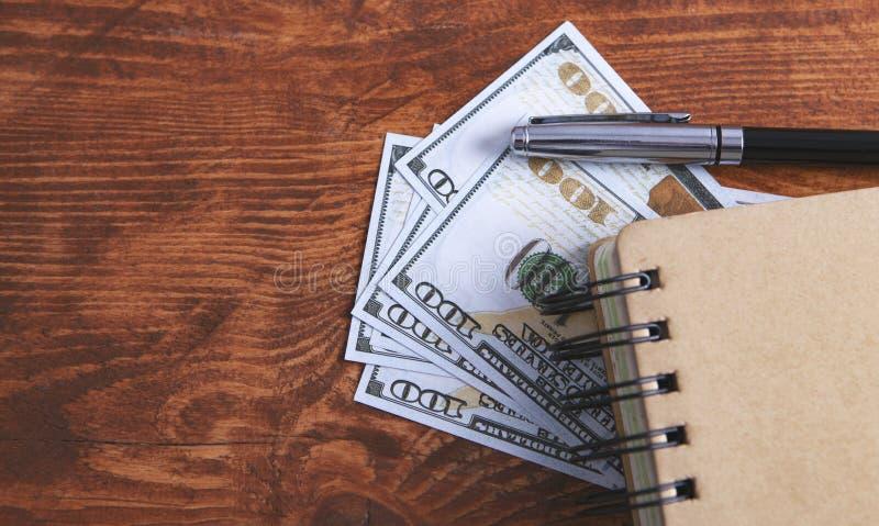 Dollari di penna del taccuino immagine stock