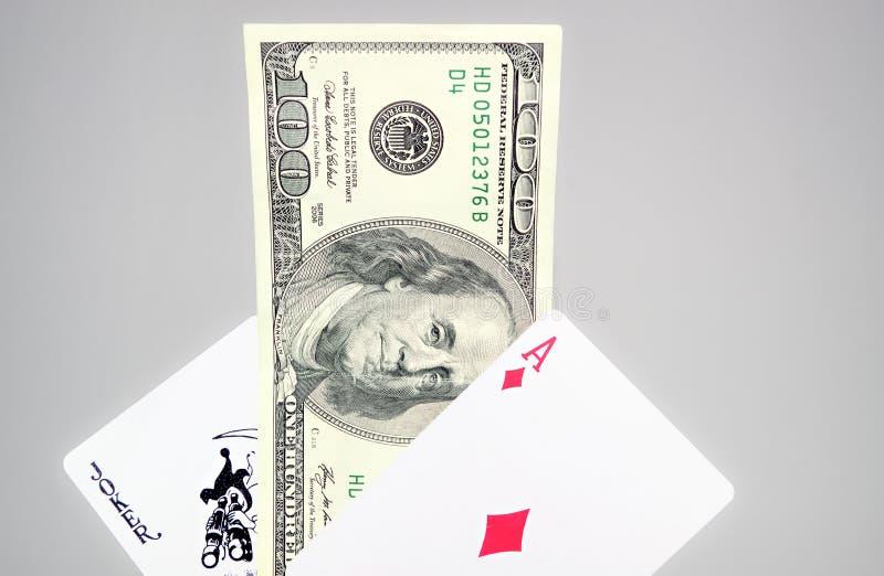 Dollari e carte da gioco fotografie stock