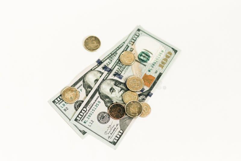 Dollari e centesimi isolati su fondo bianco fotografia stock