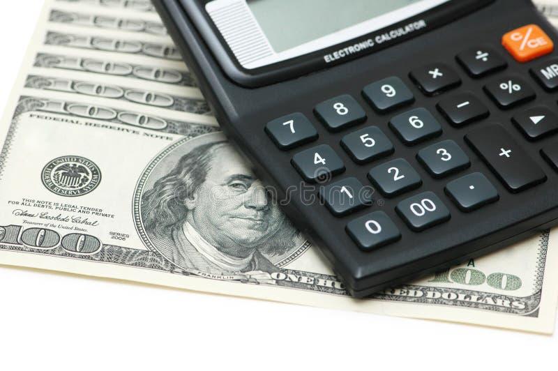 Dollari e isolat dei calcolatori fotografia stock