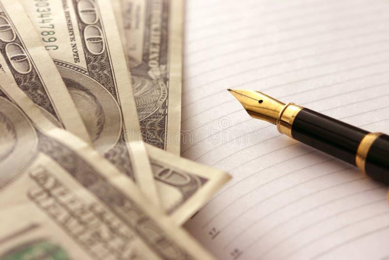 Dollari e penna fotografia stock libera da diritti