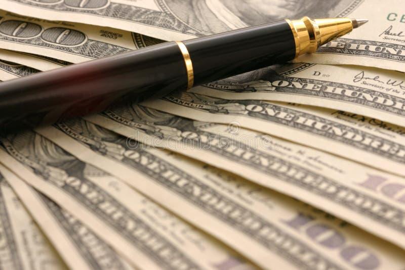 Dollari e penna fotografia stock