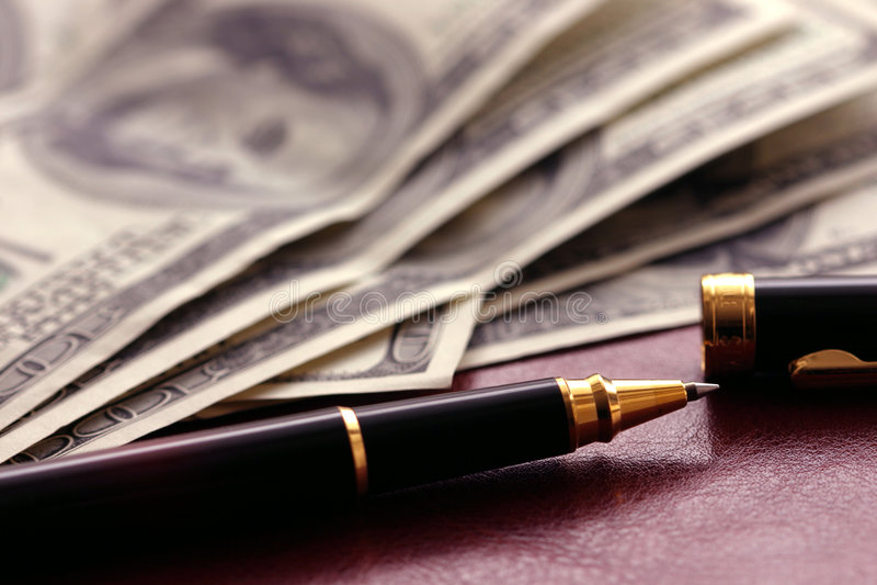 Dollari e penna immagine stock