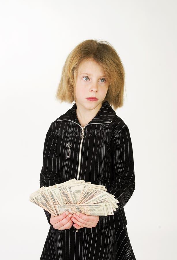 Dollari e ragazza. fotografia stock libera da diritti