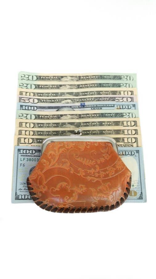 Dollari e una borsa fotografie stock libere da diritti