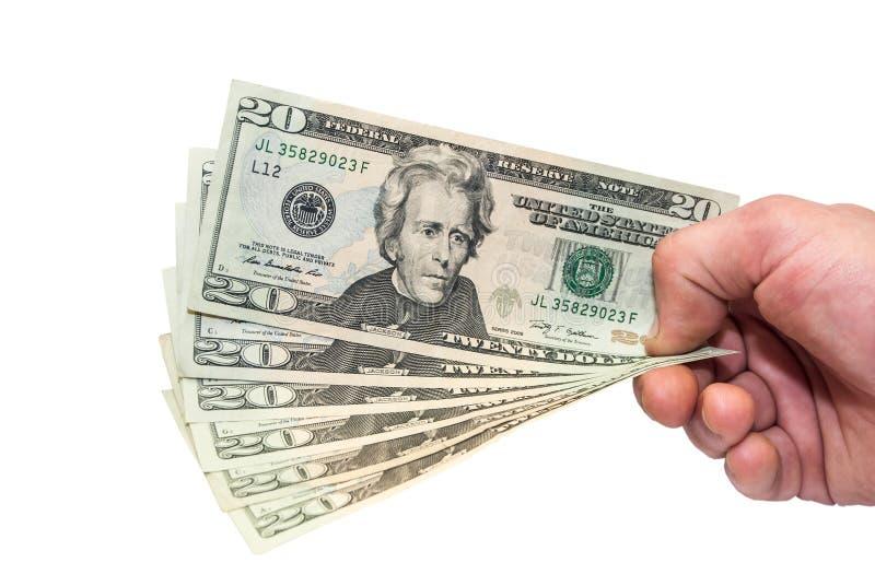 Dollari nella mano fotografia stock