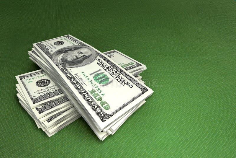 Dollari su verde fotografia stock