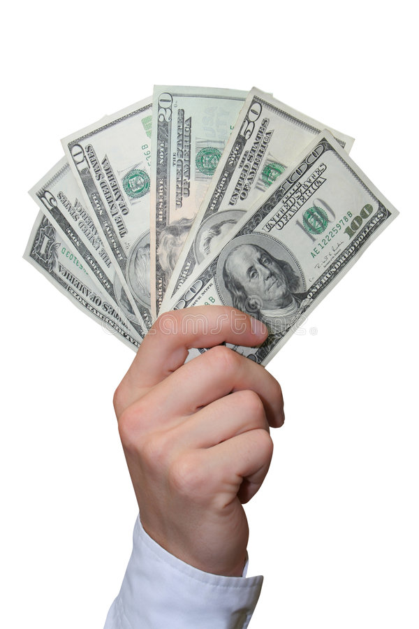 Dollari in una mano fotografia stock