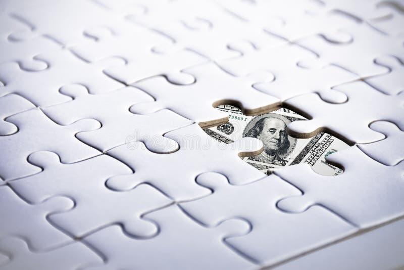 Dollaro americano dietro il puzzle Commercio e concetto finanziario Marketi immagine stock libera da diritti