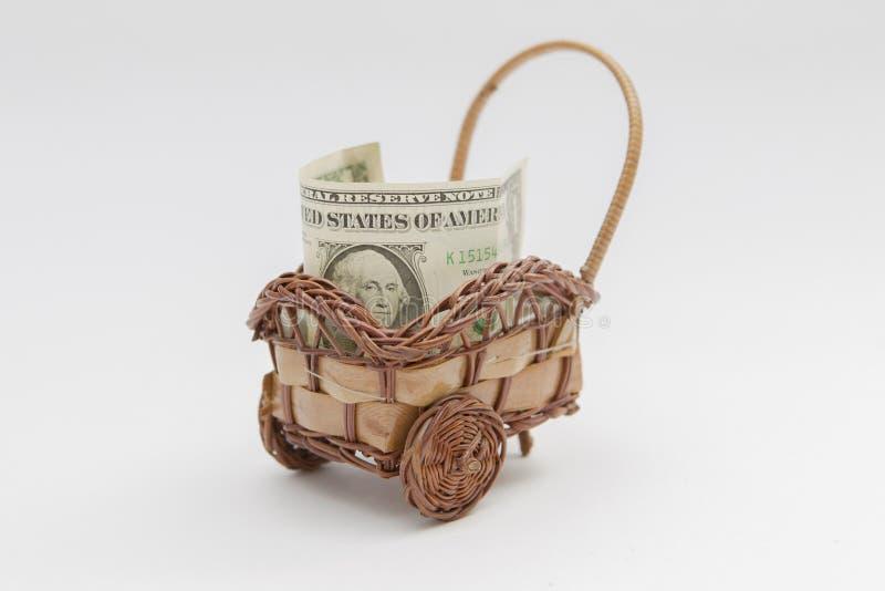 Dollarräkning inom en träkorg arkivbilder