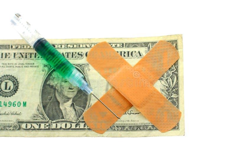 Dollarrechnung mit bandaids lizenzfreie stockbilder