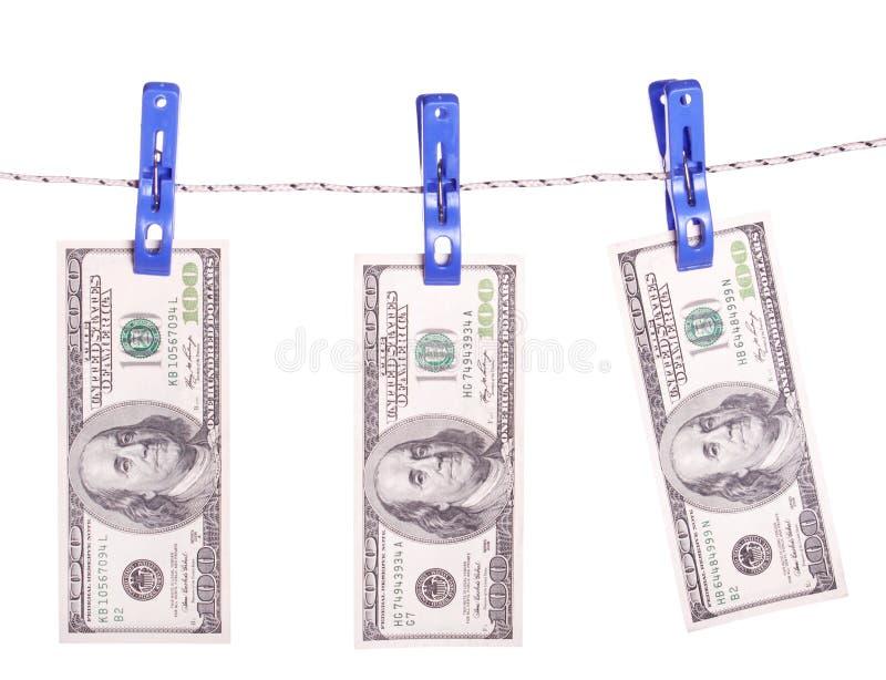 Dollarrekeningen die op kabel in bijlage met wasknijpers hangen royalty-vrije stock foto