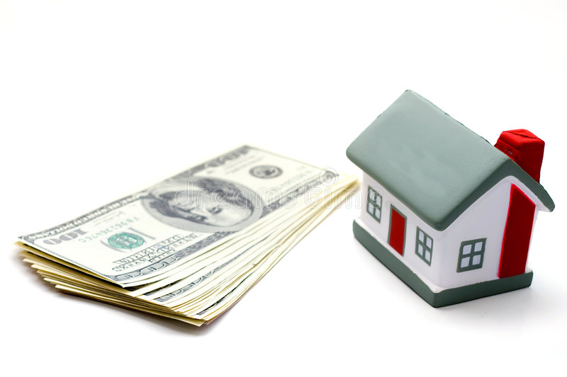 Dollars. House with dollar bills background stock photo
