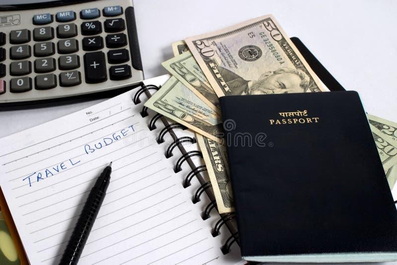 Dollars avec le passeport et la calculatrice photographie stock