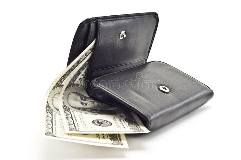 DOLLARS IN A BLACK WOMEN S PURSE