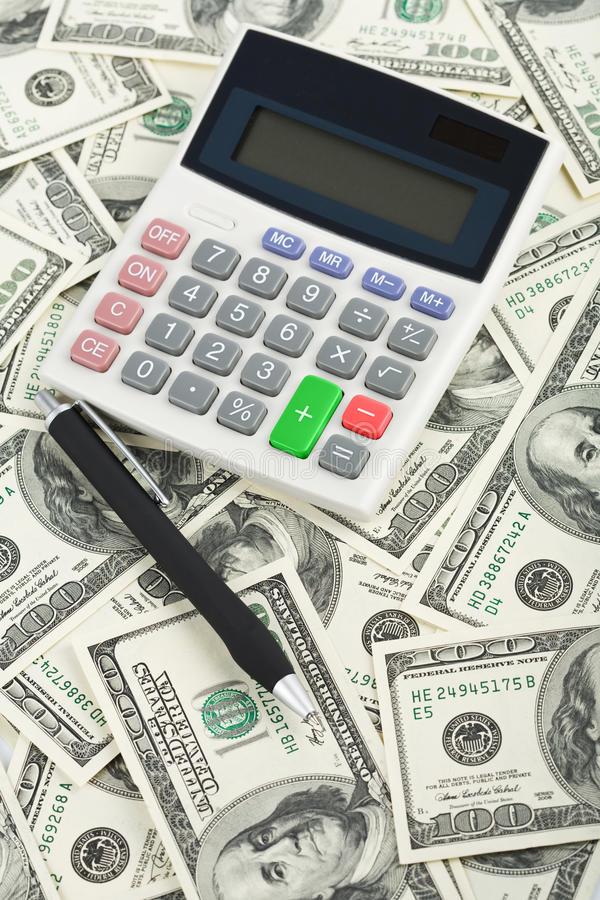 Download Dollars and calculator stock photo. Image of accounting - 9745816