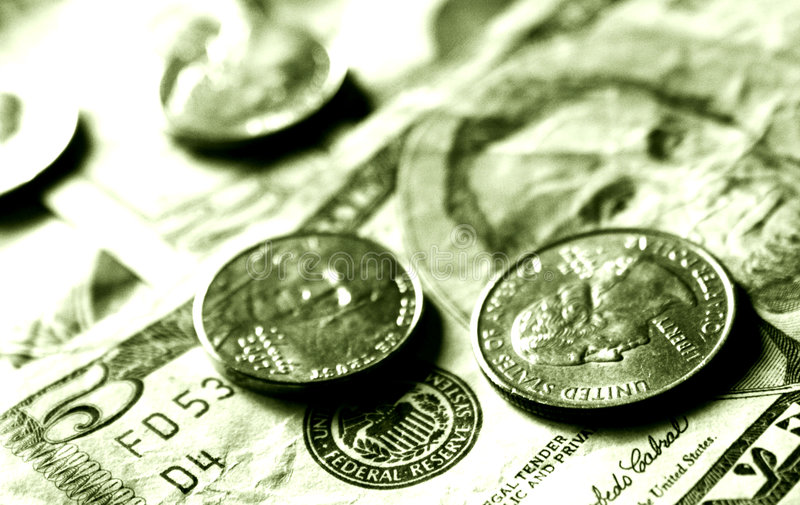 Dollars and cents. Five dollar bill with quarter and nickle with a green wash stock images