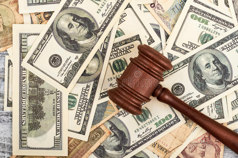 Dollars and chairman hammer. Court of justice royalty free stock photo