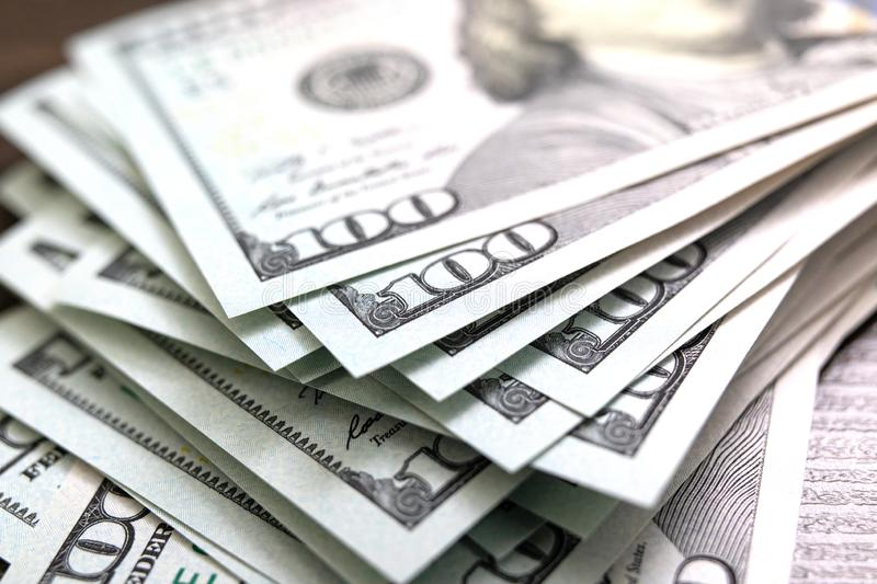 Dollars closeup. American cash money. One hundred dollar banknotes. stack of dollars spread out stock image