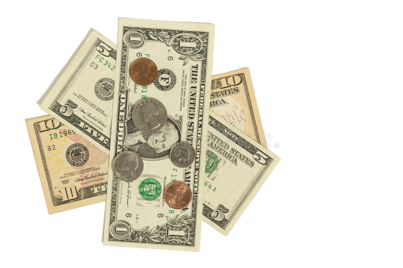 Dollars & Coins. A one, five, and a ten dollar bill with coins royalty free stock photography
