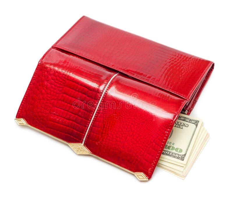 Dollars dans la bourse rouge photographie stock libre de droits