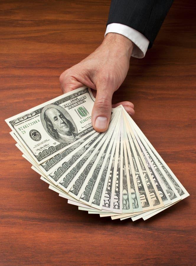 Dollars de van de Bedrijfs hand van het geld van het Contante geld stock foto's