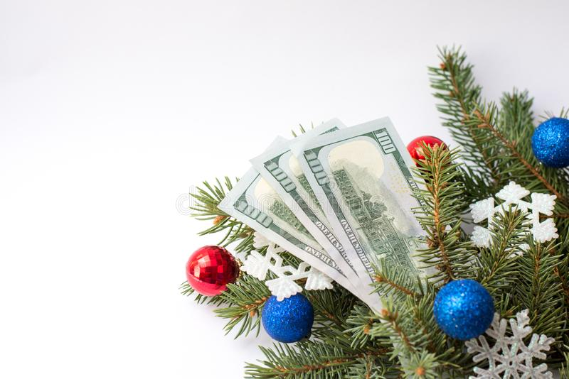 Dollars with decoration and Christmas tree isolated on white background, copy space stock images