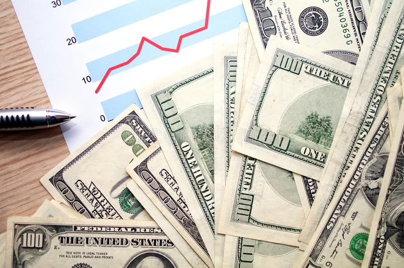 Dollars with document showing financial profit graph royalty free stock photos
