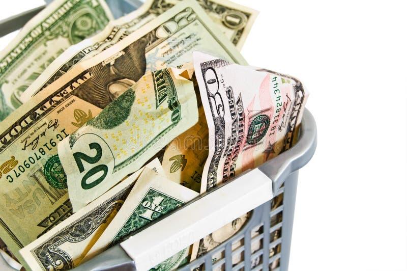 Dollars in een plastic mand. royalty-vrije stock foto's