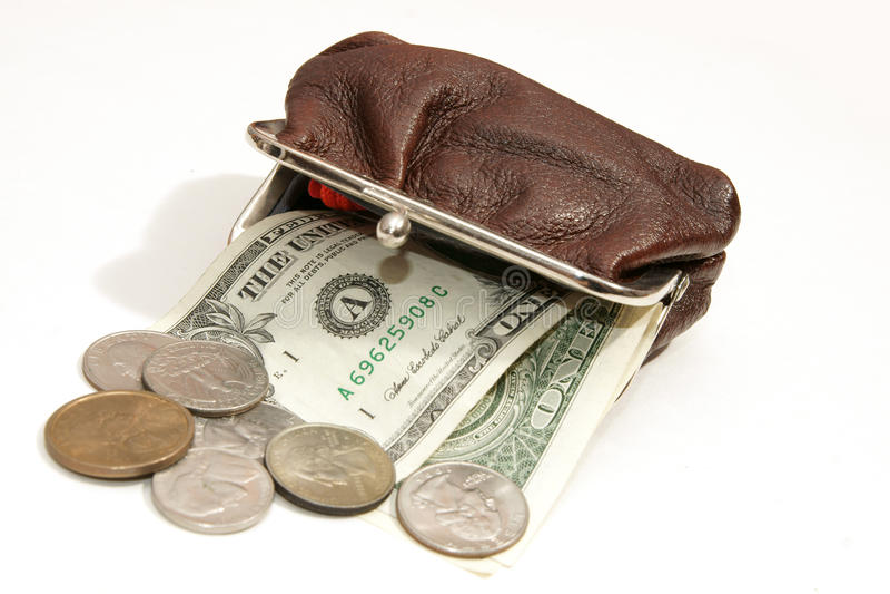 Dollars en muntstukken in zak royalty-vrije stock fotografie