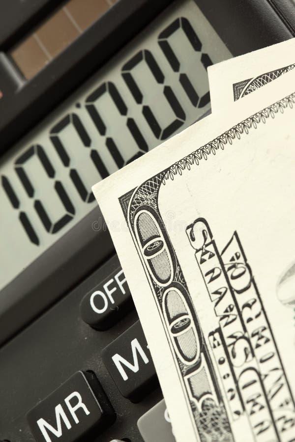 Dollars et calculatrice images stock