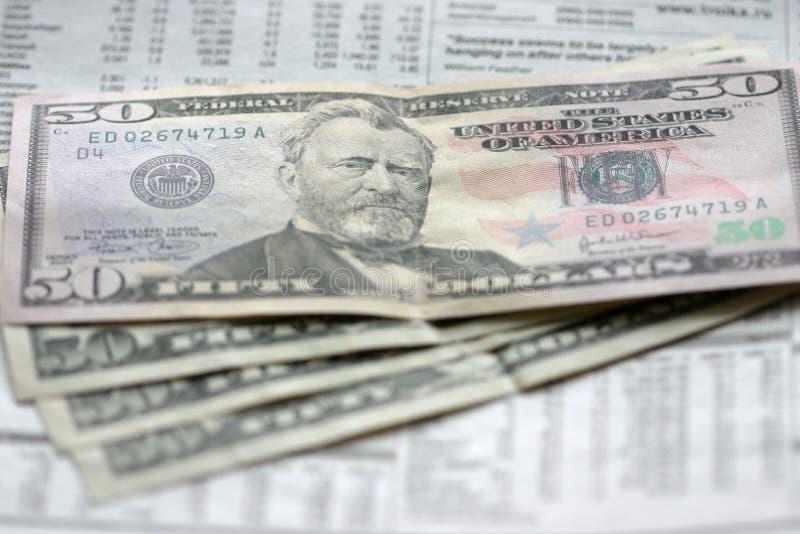 Dollars et journal photo stock