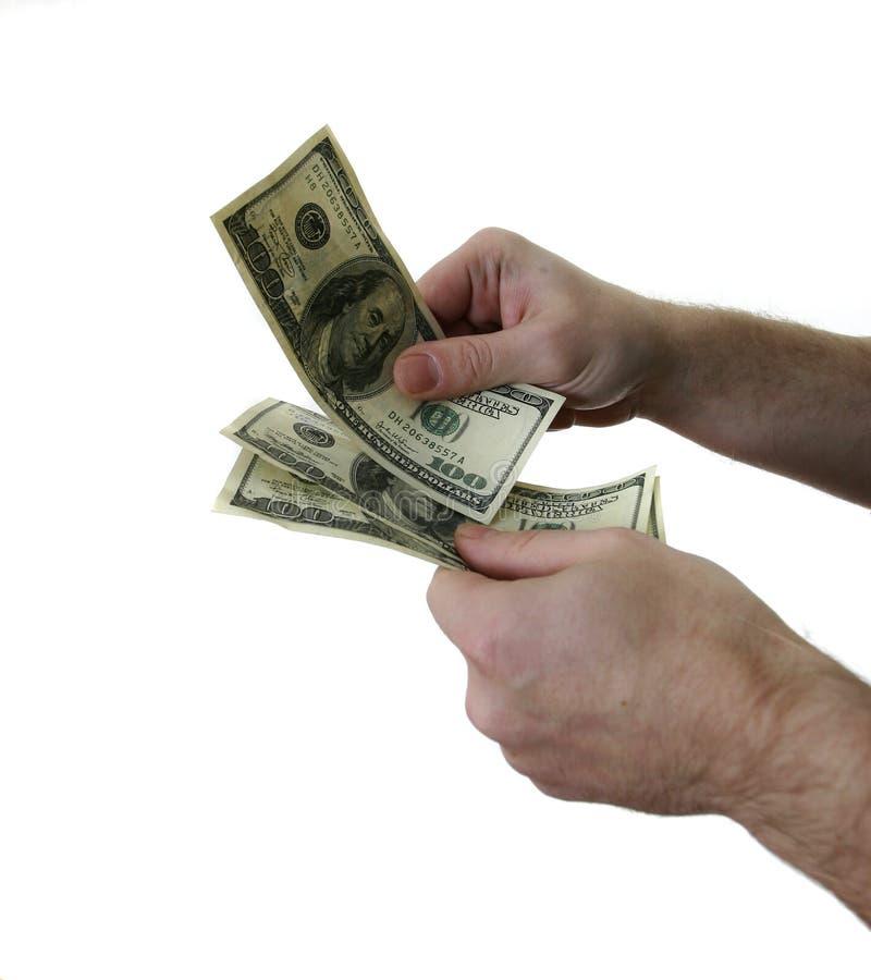 Dollars et main de l'homme photo stock