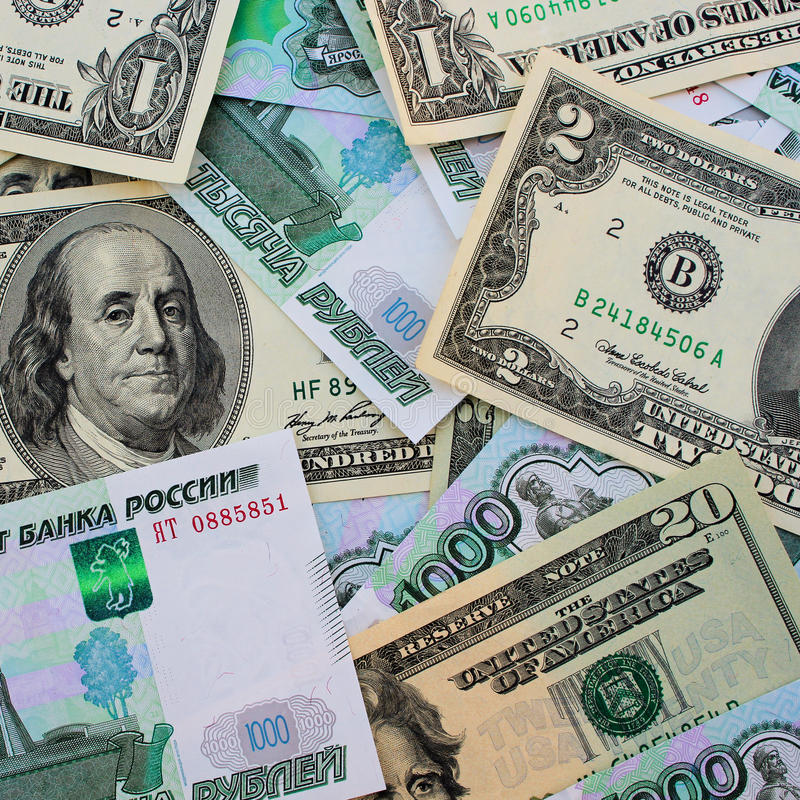 dollars et roubles russes photographie stock