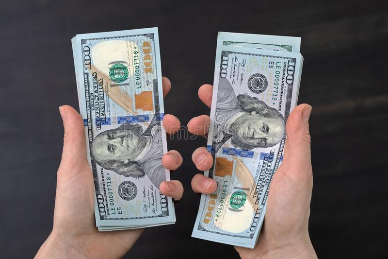 dollars with the face of benjamin franklin in the palms look at you royalty free stock photo