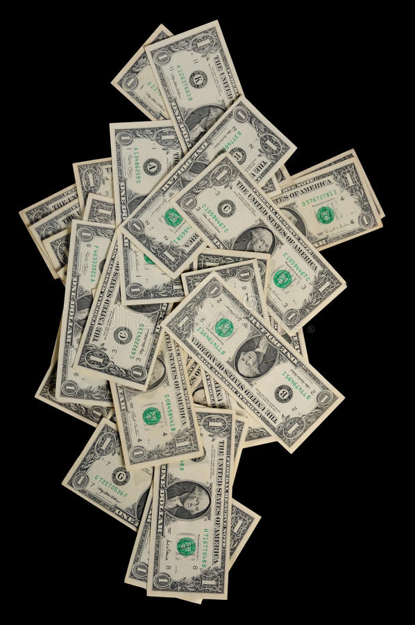 Dollars falling down. Isolated dollars falling down on the black background royalty free stock image