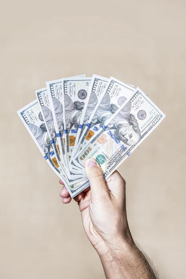 Dollars fan the bills one hundred dollars in hand stock photography
