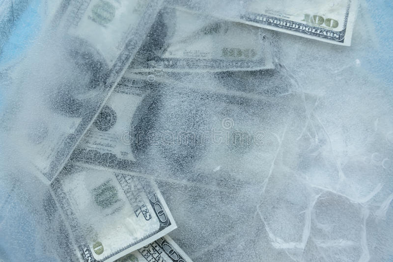 100 dollars frozen melt. stock images