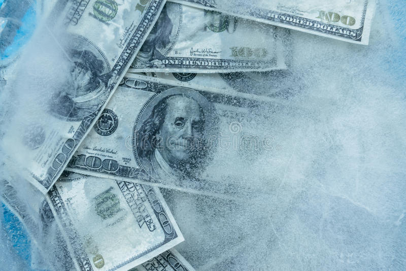 100 dollars frozen melt. royalty free stock image
