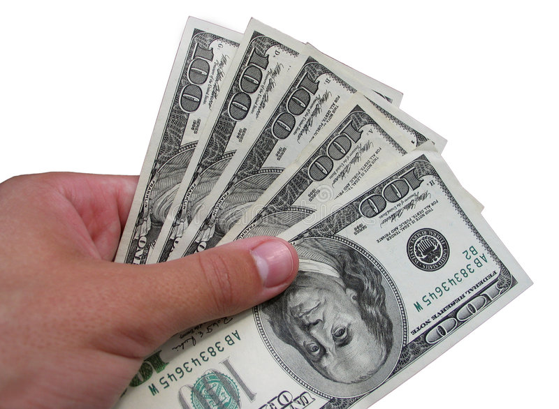 Dollars in a hand royalty free stock image